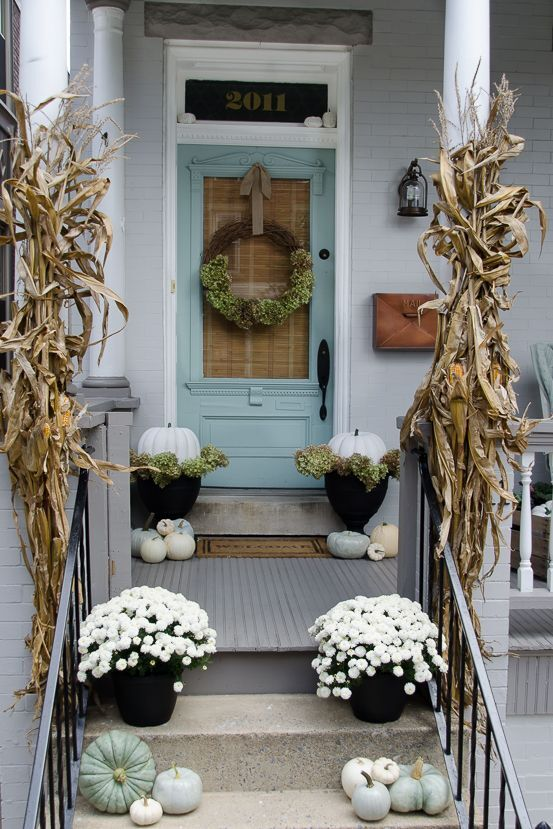 A front porch beautifully decorated for autumn